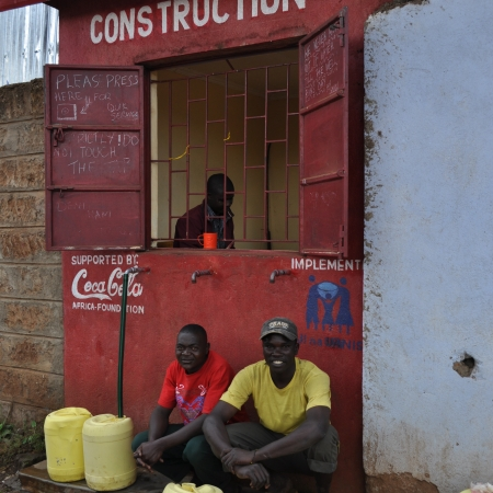 Men at a water storefront, Kibera slum